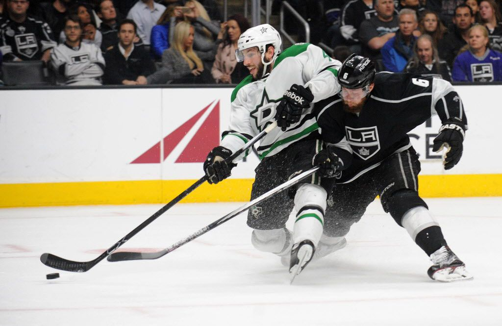 January 19, 2016; Los Angeles, CA, USA; Dallas Stars defenseman Jason Demers (4) moves in for a shot on goal against the defense of Los Angeles Kings defenseman Jake Muzzin (6) during the first period at Staples Center. Mandatory Credit: Gary A. Vasquez-USA TODAY Sports