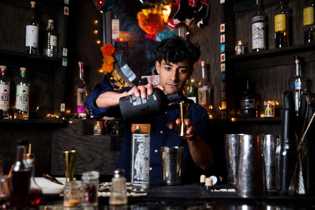 Bartender Daniel Zapata mixes a Palani drink, which contains tepache, at Santos y Pecadores in Dallas.