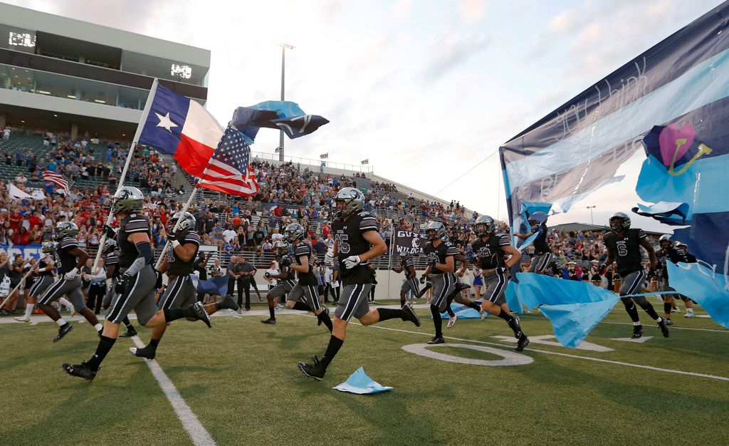 Denton Guyer takes the football field during introductions before a football game against Southlake Carroll High School at C.H. Collins Complex in Denton, on Friday, October 4, 2019. (Vernon Bryant/The Dallas Morning News)