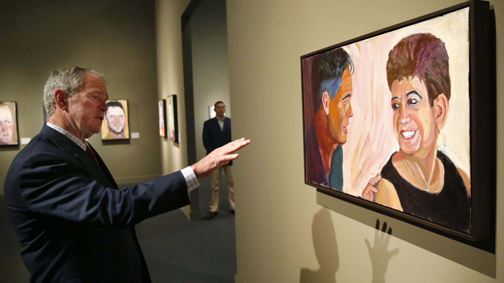 Former President George W. Bush describes the technique he used to make an oil painting of retired U.S. Air Force Master Sgt. Roque Urena during a private tour of 'Portraits of Courage, A Commander In Chief 's Tribute To America's Warriors' exhibit which showcases his oil paintings at the George W. Bush Presidential Center in University Park, Texas, Friday, February 24, 2017.  On display are 66 full-color portraits and a four-panel mural of United States military who've served with honor since 9/11Ñand whom Bush has come to know personally over the years. It opens March 2nd and runs through October 1st.