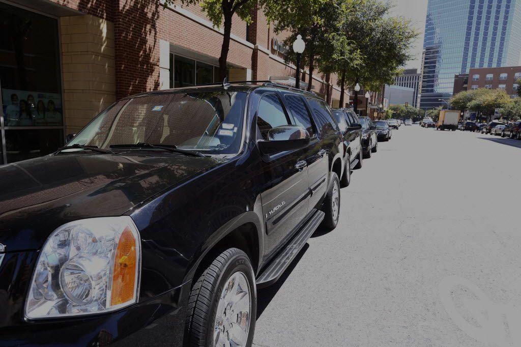 Uber Black SUVs line up in Dallas.(Ron Baselice/The Dallas Morning News)