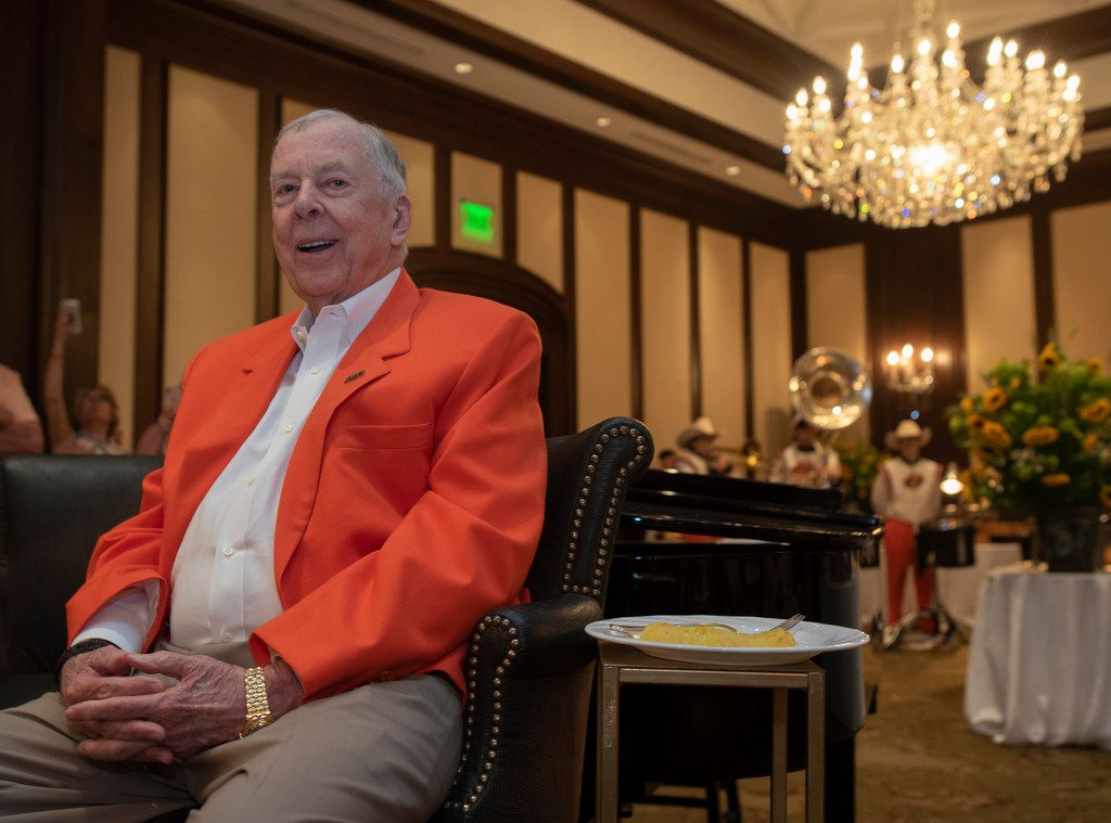 T. Boone Pickens listens to the Oklahoma State University band play during his 90th birthday party at the Dallas Country Club on Saturday, May 19, 2018.