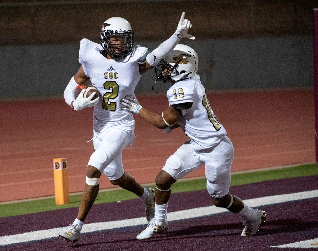 South Oak Cliff senior defensive back Courtline Flowers (2) celebrates with sophomore defensive back Donovan Lewis (19) after catching a deflected punt in the end zone for a touchdown in the second half of a high school football game against Skyline on Friday, August 30, 2019 at John Kincaide Stadium in Dallas. South Oak Cliff won 22-21. (Jeffrey McWhorter/Special Contributor)