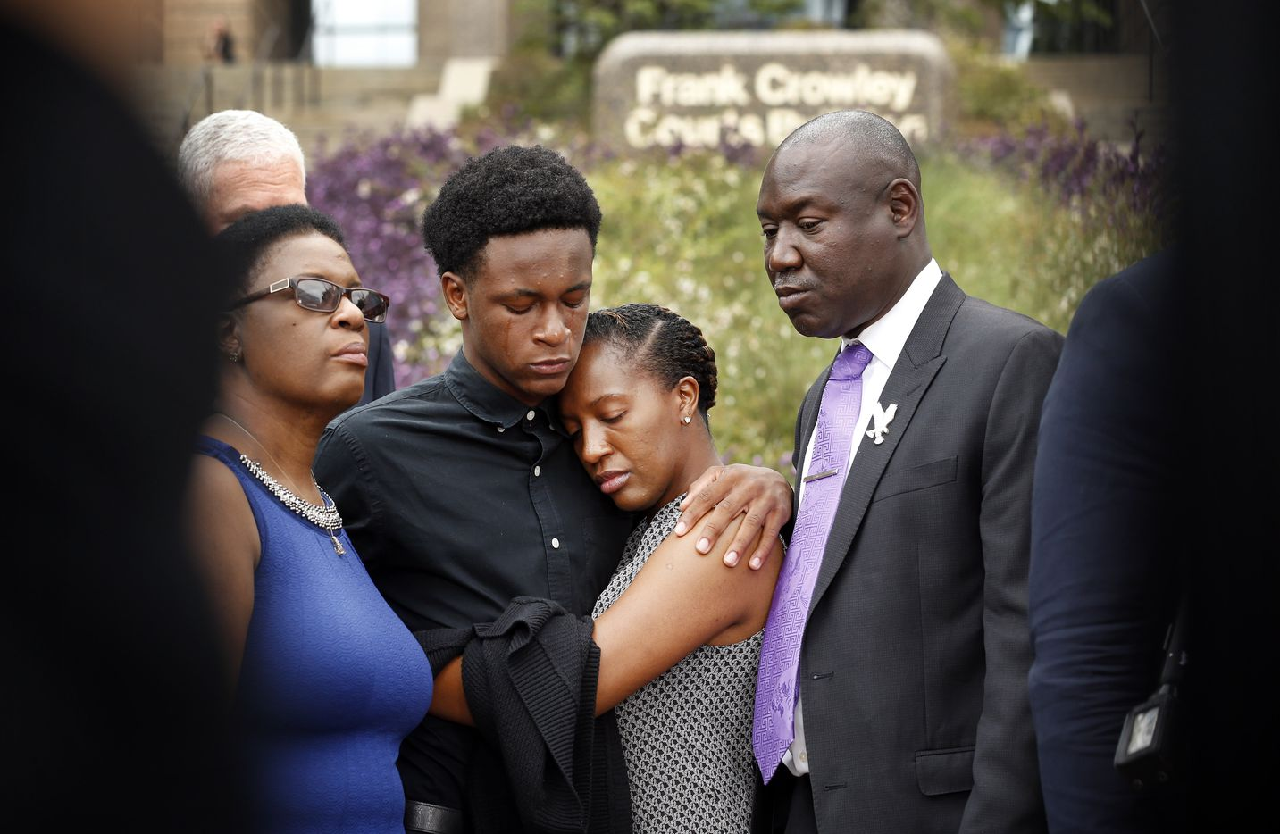 Brandt Jean, brother of shooting victim Botham Jean (second from left), hugs his sister Allisa Findley during a press conference outside the Frank Crowley Courts Building in reference to the shooting of Jean by Dallas police officer Amber Guyger, Monday, September 10, 2018. He was joined by his mother, Allison Jean (left) and attorney Benjamin Crump (right).