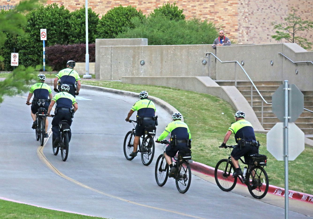 Dallas police officers bicycle to the entrance to the emergency room at Presbyterian Hospital in Dallas. Two Dallas policemen were reportedly shot at a nearby Home Depot and reportedly were transported to the Dallas hospital on April 24, 2018.