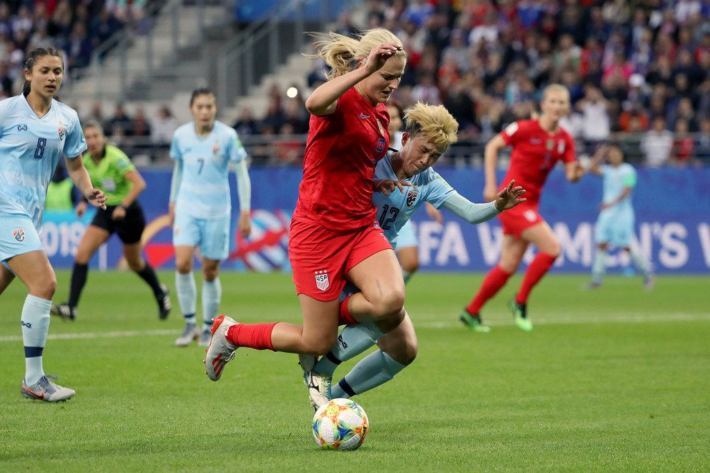 Lindsey Horan of the USA is challenged by Rattikan Thongsombut of Thailand inside the penalty area during the 2019 FIFA Women's World Cup France group F match between USA and Thailand at Stade Auguste Delaune on June 11, 2019 in Reims, France. (Robert Cianflone/Getty Images/TNS)