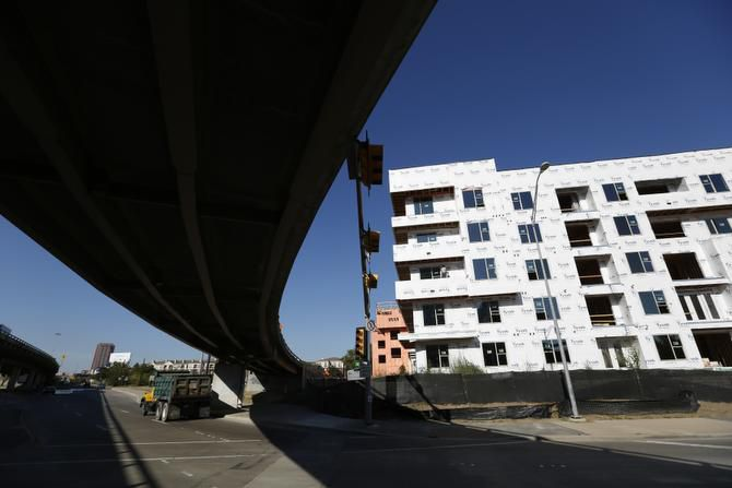 Near an exit ramp off Central Expressway, the 424-unit Elan City Lights apartment project is going up at Live Oak and Good Latimer. About 8,000 units are being built in and around downtown Dallas.
