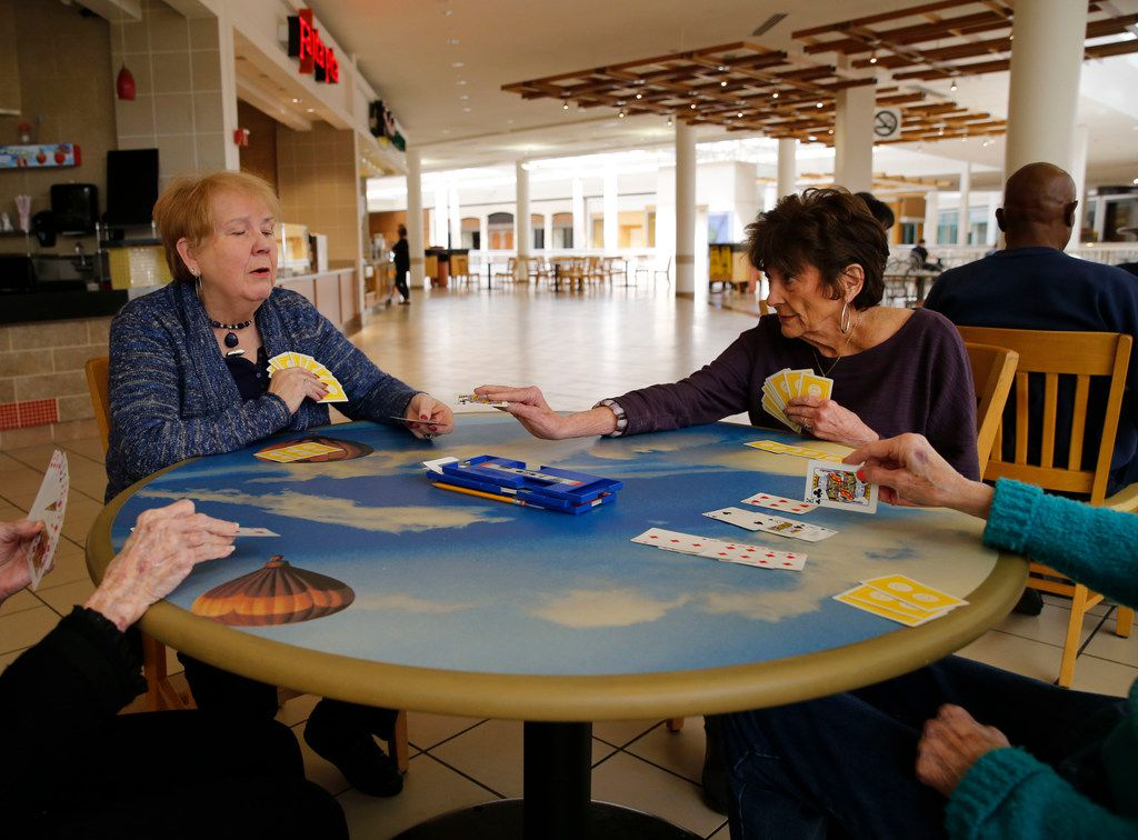 Betty Duke-Ruhd (left) and Connie Hooper (right) of Plano play bridge with friends in the food court at Collin Creek Mall/