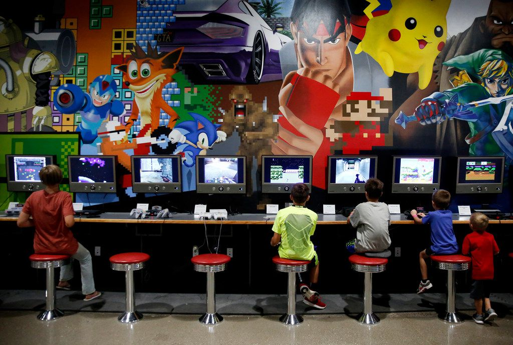 Boys play video games at the National Videogame Museum in Frisco on  Aug. 2, 2018. (Rose Baca/The Dallas Morning News)
