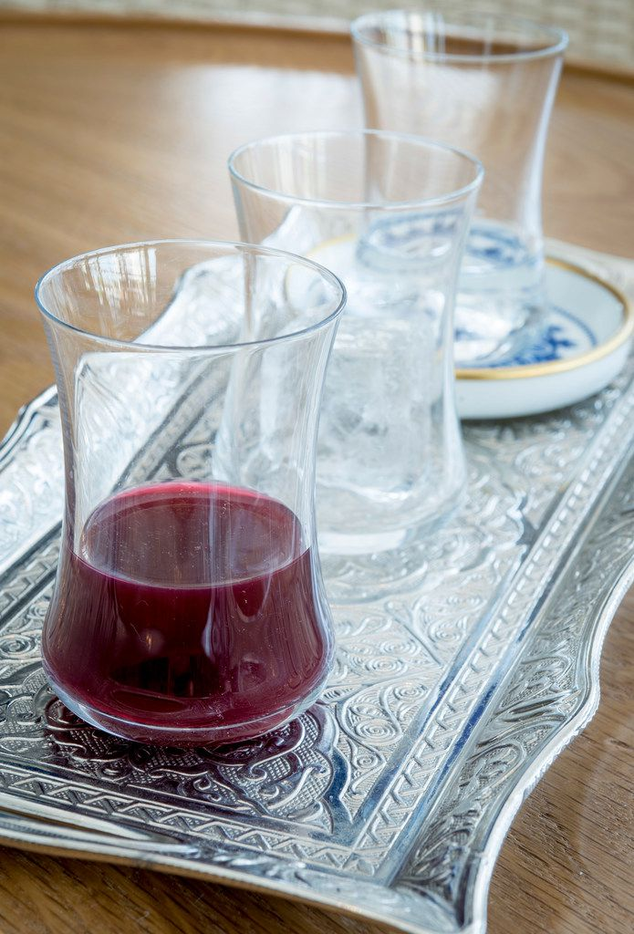 Raki, a potent anise-flavored Turkish liquor, is served on a silver tray with ice and water.