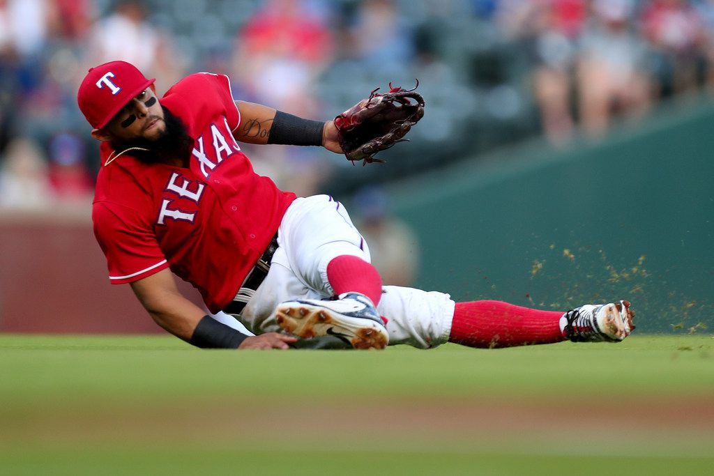 ARLINGTON, TX - AUGUST 06:  Rougned Odor #12 of the Texas Rangers fields a ground ball hit by Dee Gordon #9 of the Seattle Mariners in the top of the first inning at Globe Life Park in Arlington on August 6, 2018 in Arlington, Texas.  (Photo by Tom Pennington/Getty Images)