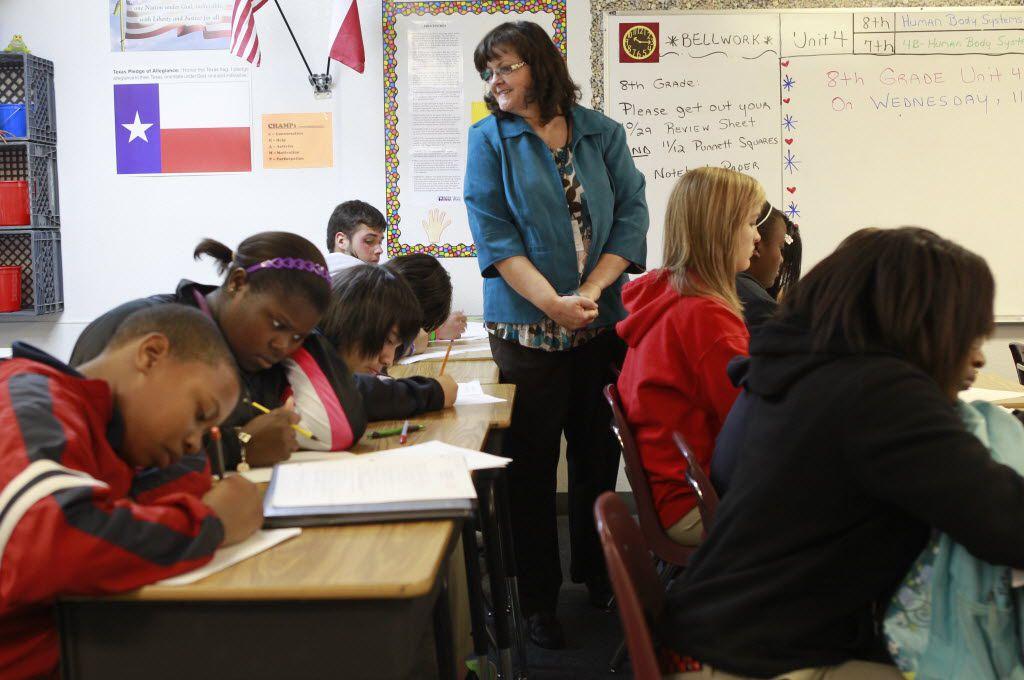 Debra Dickinson oversees eighth-graders in science class at Advantage Academy's Dallas campus on Joseph Hardin Drive.  (2010 File Photo/Staff)