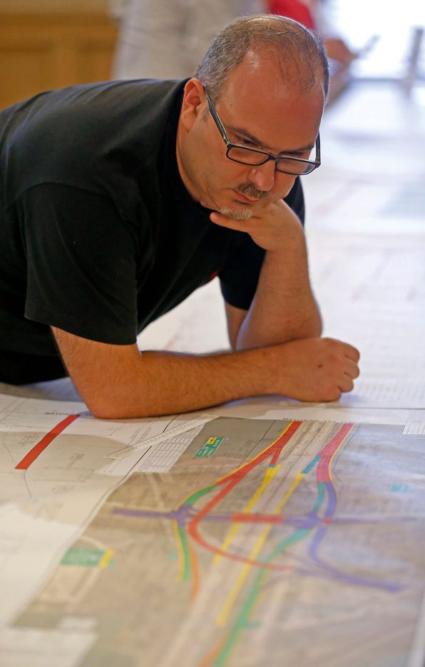 Garland resident George Andrea takes a look at a map of the planned I-30 frontage road project. (Jae S. Lee/Staff Photographer)