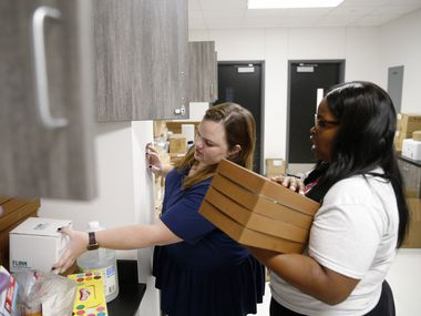 Science teachers Corinne Brosey (left) and Lydia Albritton (right) worked on getting all the science supplies organized before the school year started at Hays Middle School in Frisco.