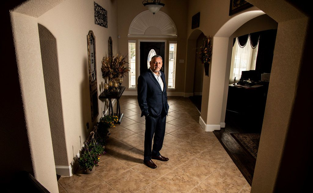 Ron Hernandez poses a photograph in his Dallas home on Friday, Feb. 8, 2019. Shortly after arriving home from work on Wednesday afternoon, Hernandez was home with his roommate when a man entered his home through the car garage demanding that Hernandez give him his keys.