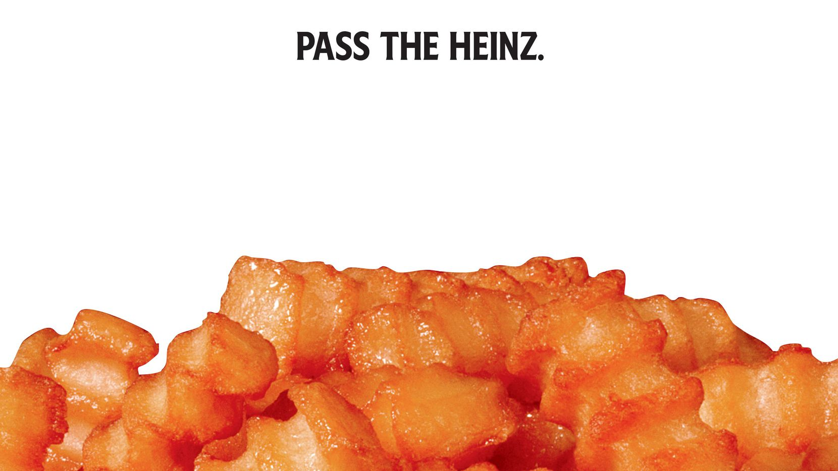 """This photo provided by Heinz shows a Heinz ketchup ad inspired by the TV show """"Mad Men."""" The idea of the campaign, which shows foods like French fries and hamburgers up close without any condiments, is to underscore that they need ketchup to be complete. (Courtesy of Heinz via AP)"""