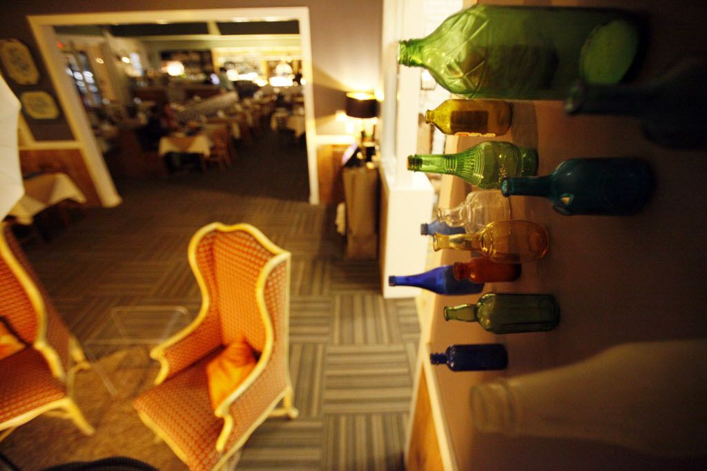 Bottles decorate the walls.