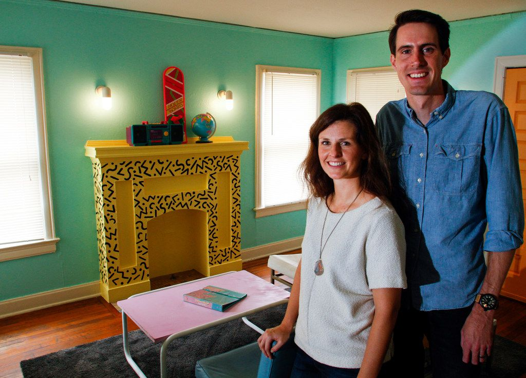 Owners Jeremy and Kelsey Turner in the living room of The McFly.  On the table: a Trapper Keeper that inspired the color scheme.