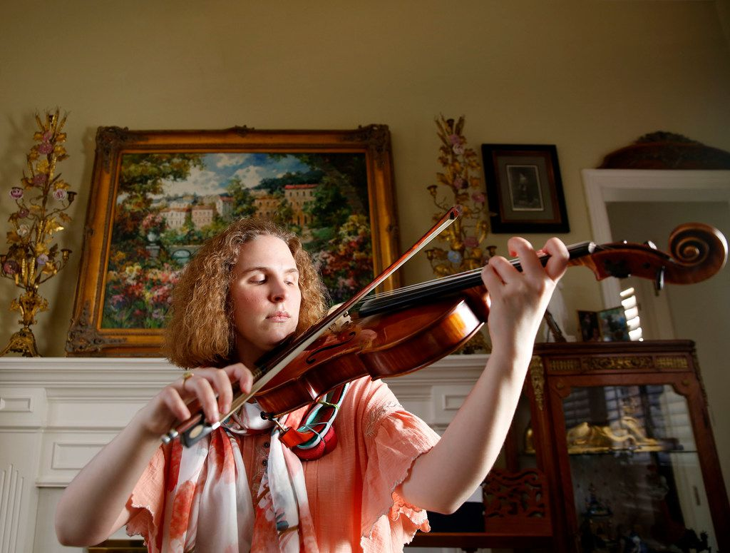 Rebecca Glass plays her viola in her home in Plano.