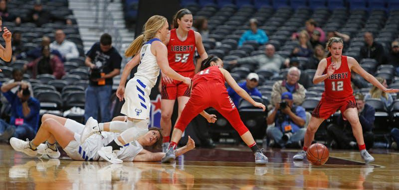Kailyn Lay follows the ball after stealing it from Kerville's Catherine Kaiser. Kerrville Tivy v Frisco Liberty in 5A semifinals at the Alamodome in San Antonio, TX on Thursday, February 28, 2019. ORG XMIT: 10043967A