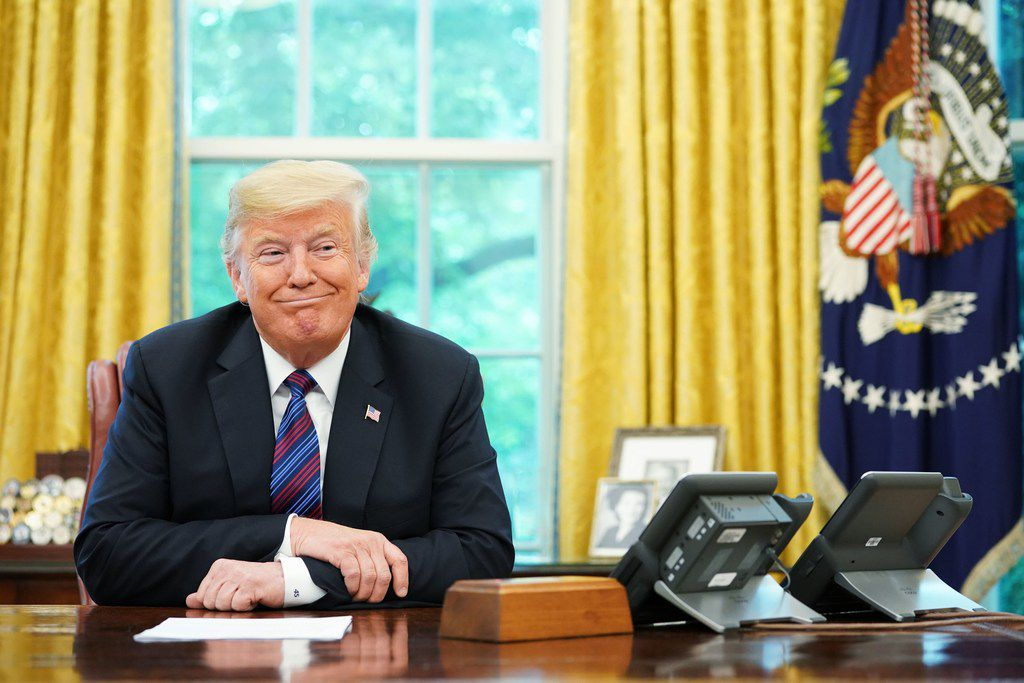 President Donald Trump listens during a phone conversation with then-Mexico President Enrique Pena Nieto on trade in the Oval Office on Aug. 27, 2018
