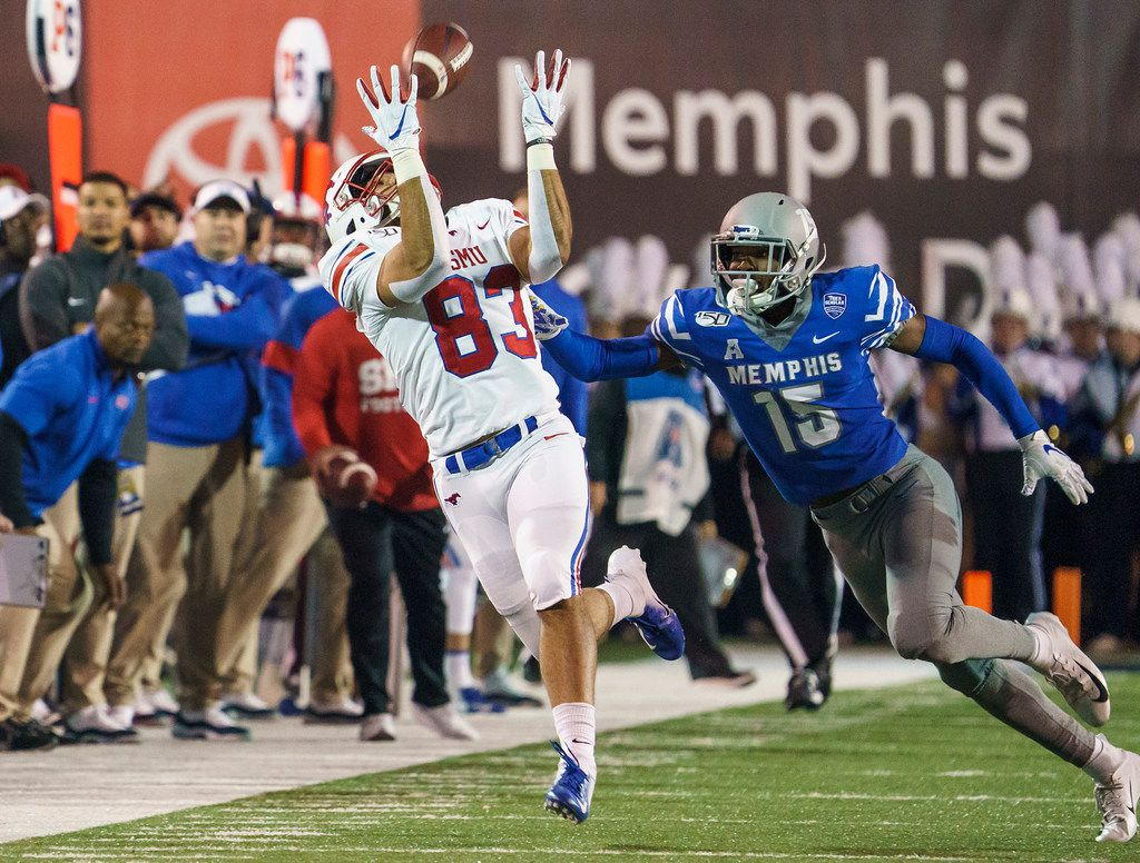 SMU tight end Kylen Granson (83) has a pass go off his hands as Memphis defensive back Quindell Johnson (15) defends during the first half of an NCAA football game at Liberty Bowl Memorial Stadium on Saturday, Nov. 2, 2019, in Memphis, Tenn. (Smiley N. Pool/The Dallas Morning News)