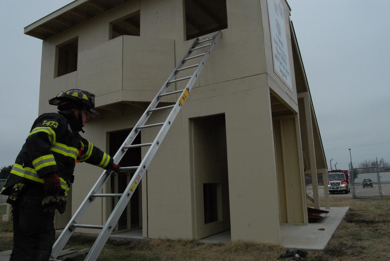 Jeremy Qualls  of The Colony Fire Department sets up a ladder for drills at the department's new training yard on Tuesday.