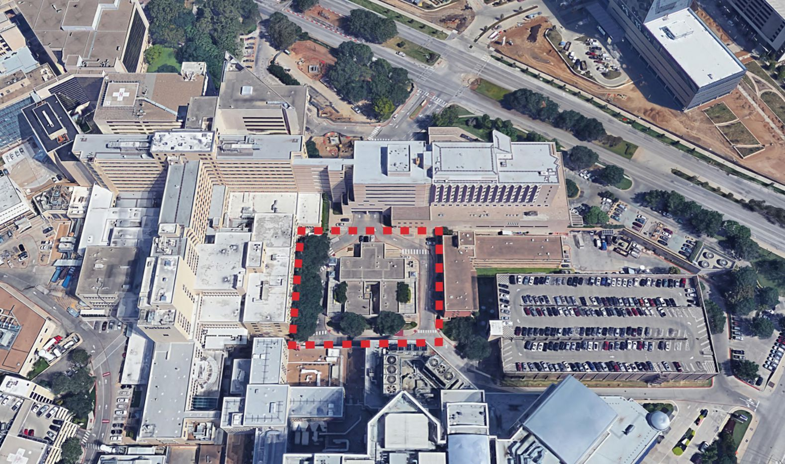 Small buildings at the center of the medical complex would be torn down for a new park area.