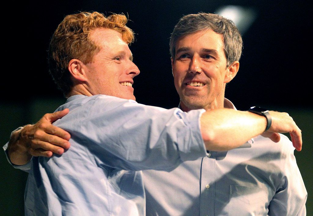 U.S. Rep. Joe Kennedy III embraces Democratic Senate candidate Beto O'Rourke during a campaign rally at the McAllen Convention Center on Saturday ,Oct. 13, 2018, in McAllen, Texas. Joe Kennedy attended Saturday's rally with O'Rourke. (Delcia Lopez/The Monitor via AP)