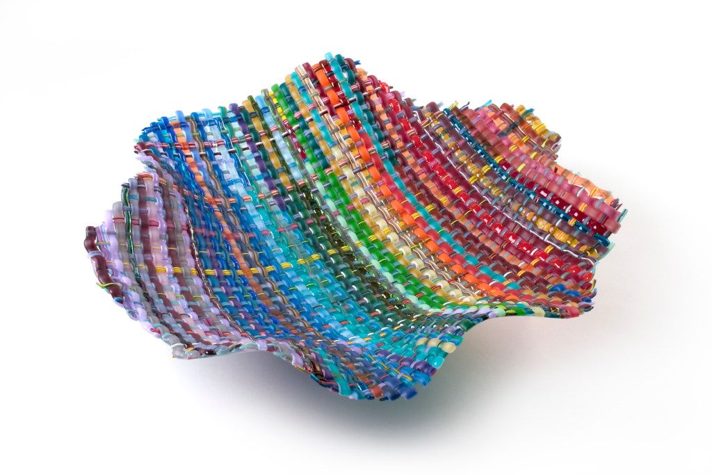 Confetti , by Eric Markow & Thom Norris, http://wovenglass.com/ Markow & Norris, represented exclusively in Texas by LMB Art Glass. The handwoven Confetti bowl by Markow & Norris, Limited Edition 45 of 50, is the most popular sculpture by the artists.