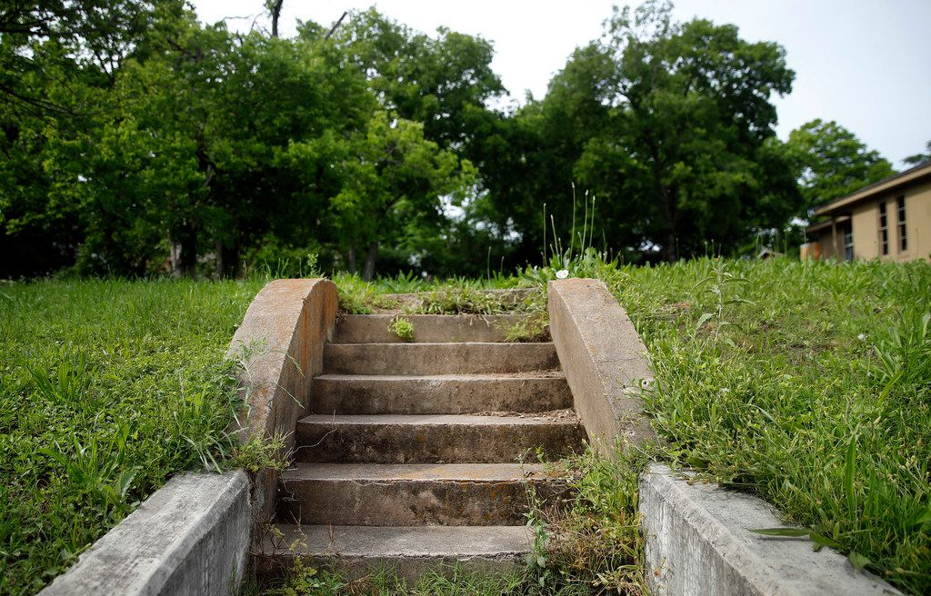 The Tenth Street Historic District is filled with steps leading to vacant lots where contributing homes once stood.