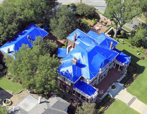 A rooftop damaged by the hailstorm sits covered with blue tarps on Swiss Avenue. The June 13 hailstorm caused more than a billion dollars of damage to Dallas property.