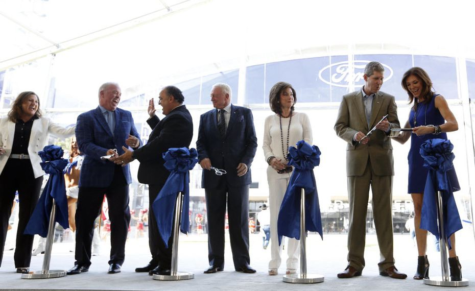 Representatives from Ford, Dallas Cowboys, City of Frisco and Frisco ISD celebrate after cutting the ribbon at a ribbon cutting ceremony at the Dallas Cowboys new headquarters at The Star in Frisco on Sunday, August 21, 2016. (Vernon Bryant/The Dallas Morning News)