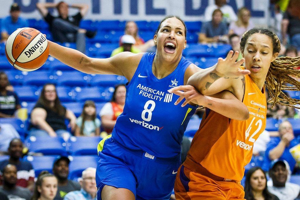 Dallas Wings center Elizabeth Cambage (8) drives to the basket as Phoenix Mercury center Brittney Griner (42) defends during the first half at College Park Center on Tuesday, June 12, 2018, in Arlington, Texas. (Smiley N. Pool/The Dallas Morning News)