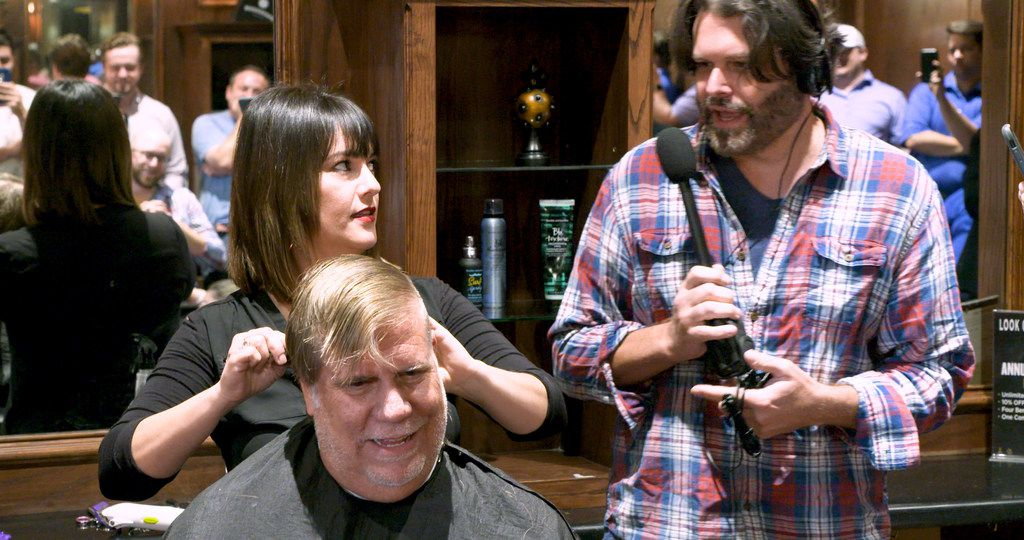 Stylist Vicky Peña begins cutting The Ticket's George Dunham's hair at Boardroom Salon for Men at Inwood Village in Dallas on Sept. 6, 2019 as co-host Gordon Keith interviews them both. Dunham lost a bet saying Cowboys' coach Jason Garrett would be fired by the end of last season. The radio host must now sport a mohawk for the entire upcoming Cowboys season. (Tommy Noel/Staff Photographer)