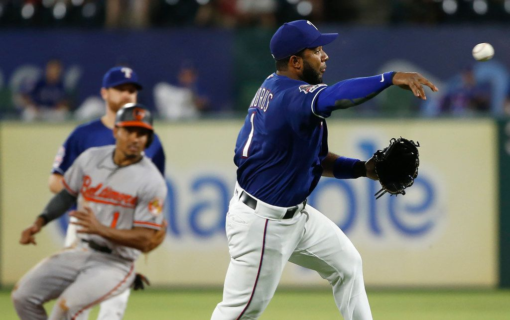 ARLINGTON, TX - JUNE 5:  Elvis Andrus #1 of the Texas Rangers throws out Hanser Alberto #57 of the Baltimore Orioles at first base during the sixth inning at Globe Life Park in Arlington on June 5, 2019 in Arlington, Texas.  (Photo by Ron Jenkins/Getty Images)