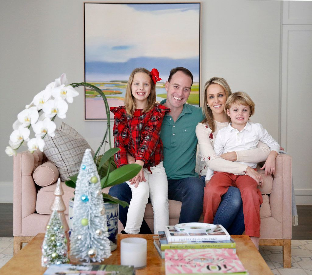KXAS anchor Meredith Land poses for a photo with her husband, Xan, son Alexander and daughter McCall at their Dallas home.