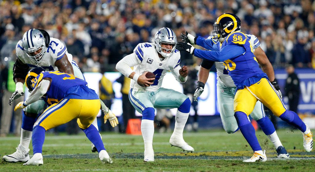 Dallas Cowboys quarterback Dak Prescott (4) takes off running before being sacked late in the second quarter by the Los Angeles Rams in their NFC Divisional Playoff game at Los Angeles Memorial Coliseum in Los Angeles, Saturday, January 12, 2019. (Tom Fox/The Dallas Morning News)