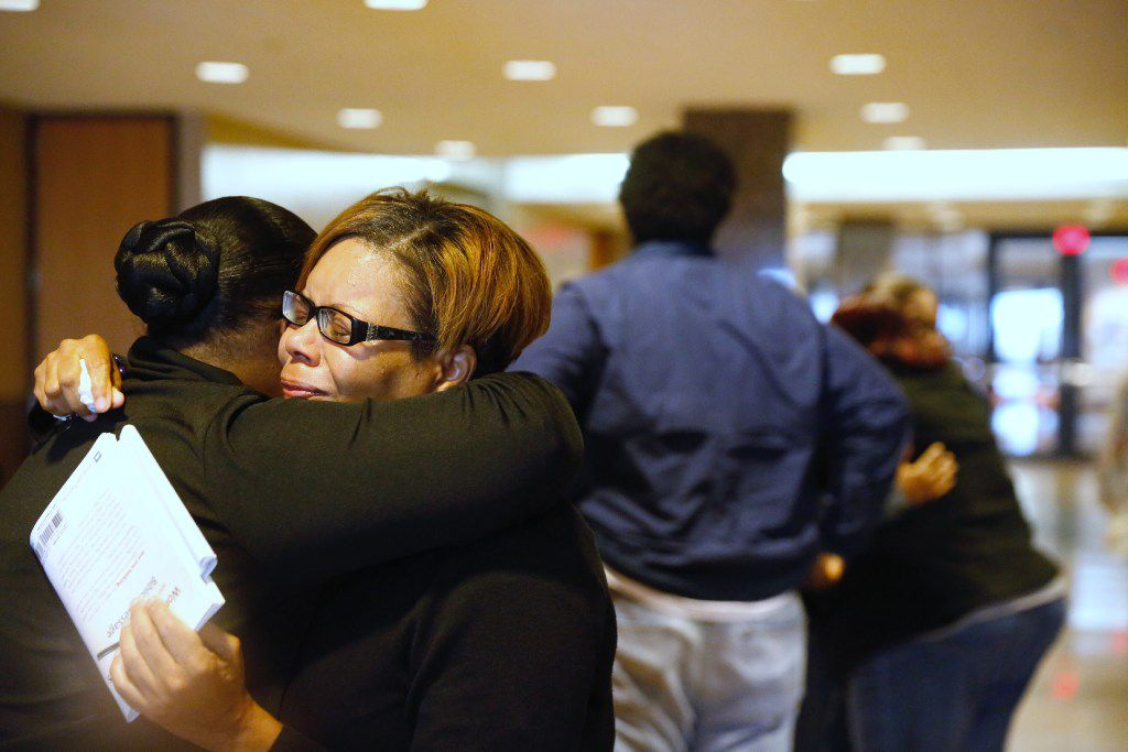 Sheritha Smith, Toya Smith's sister, hugs a relative of Zina Williams Bowser after Erbie Lee Bowser was sentenced to life in prison Friday. The jury could not agree on the death penalty.
