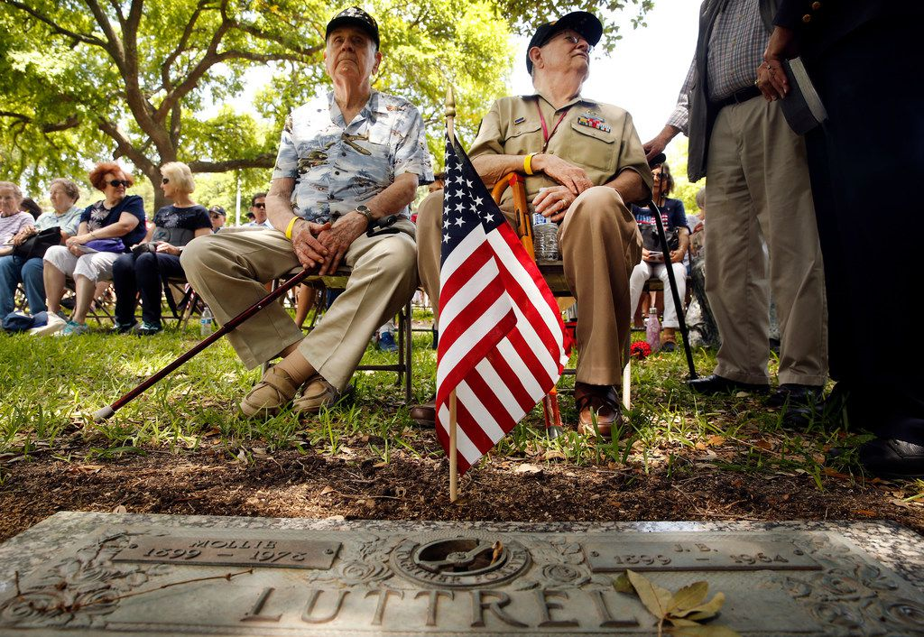 World War II veterans Jim Patterson (left) and Jimmy Holmes visit with folks among the gravestones at Restland on Monday. Patterson said he was a B-24 pilot in the South Pacific, and Holmes said he was part of the Army's 101st Airborne in Belgium.