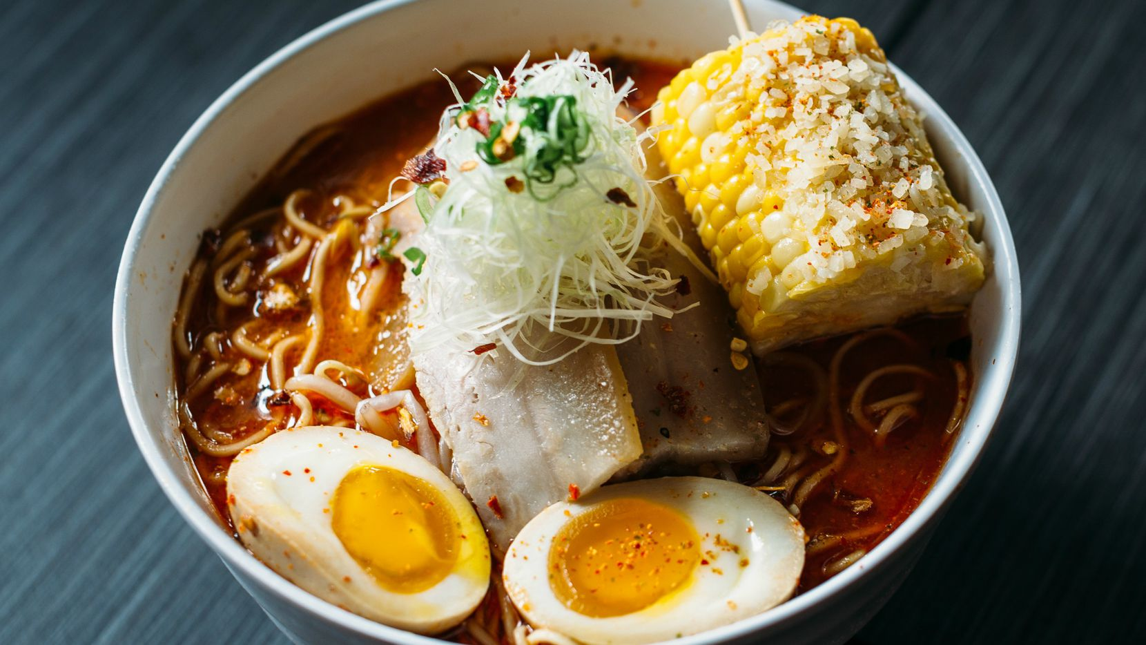 "Oni Reaper ramen at Oni Ramen, Jesus Garcia's soon-to-open shop in Fort Worth. The ""demon-spiced"" dish, garnished with pork belly, bean sprouts, spicy corn on the cob, shredded leeks and soft-boiled egg, features thick noodles in a miso broth flavored with Carolina Reaper and other peppers."