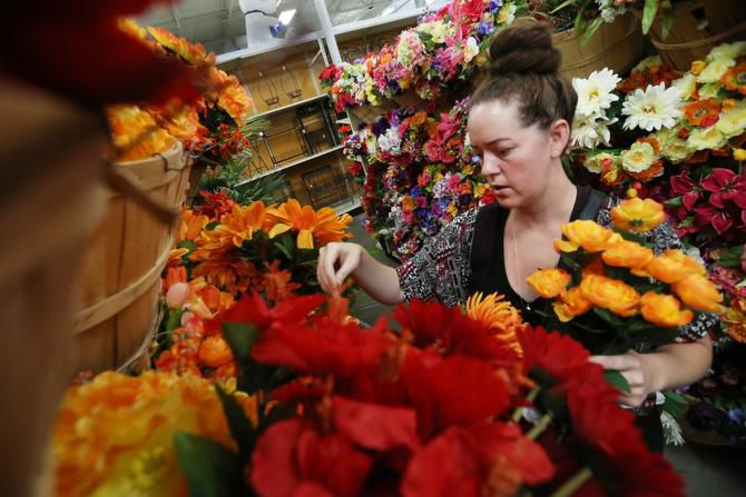 Lindsay Vonhagel of Denton shops for artificial flowers at At Home.