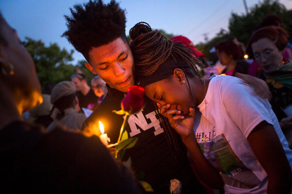 """Ashuntae Coleman, 14, is consoled by De'Juan Johnson, 15, during the """"Remember His Name: Vigil for Jordan Edwards"""" candlelight vigil at Virgil T. Irwin Park on Thursday, May 4, 2017, in Balch Springs. Edwards, a 15-year-old freshman at Mesquite High School, was shot and killed by a Balch Springs officer as Edwards was leaving a party. Coleman and Edwards had been lifelong friends since elementary school."""