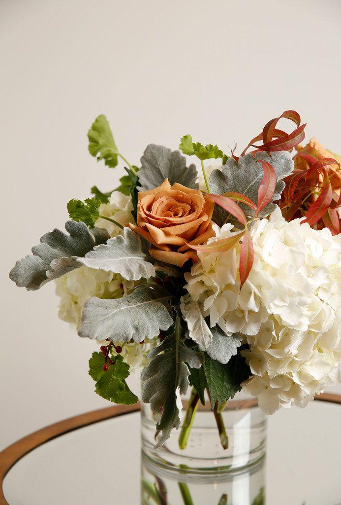 Floral arrangement including hydrangeas, Combo rose, geranium leaves, dusty miller and pistachio leaves from Avant Garden.