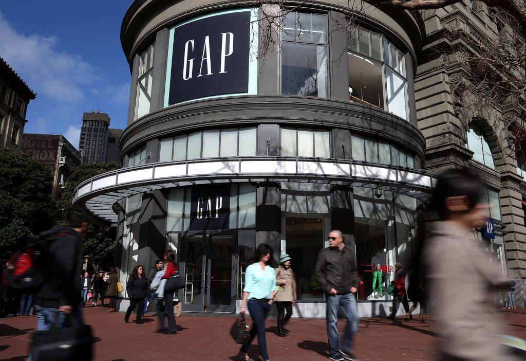 Pedestrians walk by a Gap store in San Francisco City.
