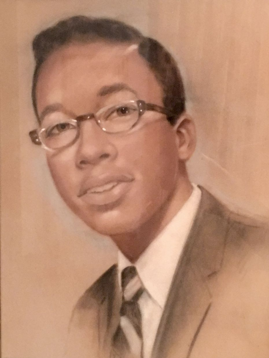 An image of John Wiley Price as a young man, one of many in a sibling's collection of family keepsakes.
