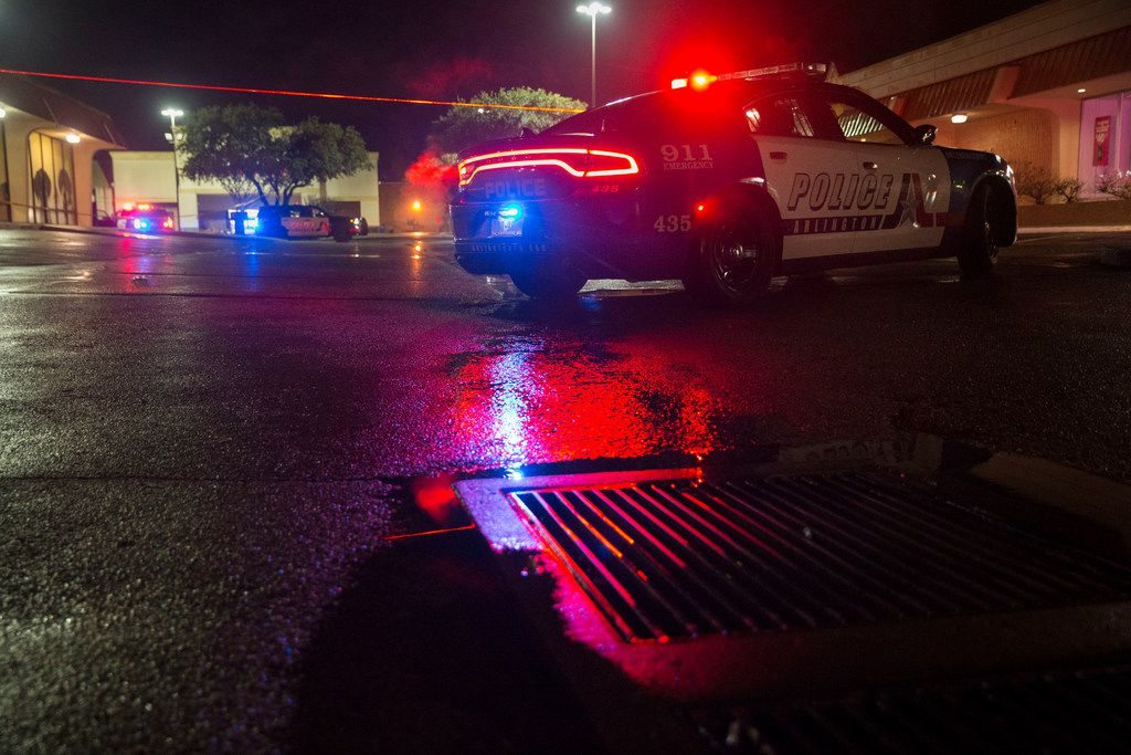 An Arlington Police Department car blocks an entrance at the location of an officer-involved shooting at the 1700 block of West Randol Mill Road near North Fielder Road in Arlington on Saturday, Jan. 12, 2019. An officer and the suspect were both shot.