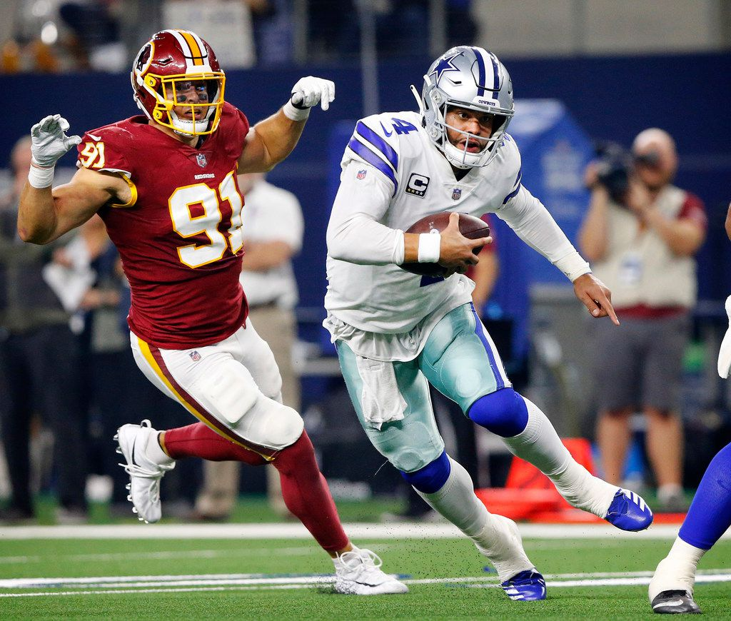 Dallas Cowboys quarterback Dak Prescott (4) races to the goal line for a fourth quarter touchdown against the Washington Redskins defense at AT&T Stadium in Arlington, Texas, Thursday, November 22, 2018. Dak kept the ball after not being able to find a receiver. The Cowboys defeated the Redskins, 31-23. (Tom Fox/The Dallas Morning News)