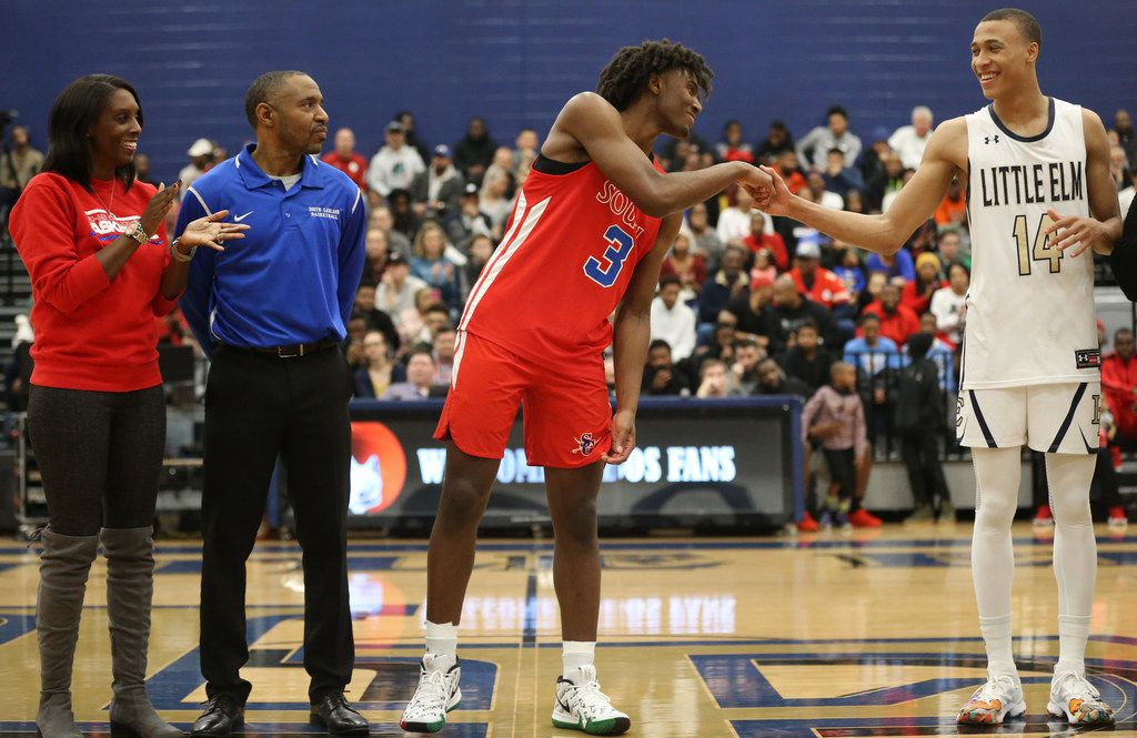 South Garland's Tyrese Maxey (3) and Little Elm's R.J. Hampton (14) greet each other after being recognized before their game at Little Elm High School in Little Elm, Texas on Friday, Dec. 14, 2018. Little Elm won 80-66. (Rose Baca/The Dallas Morning News)