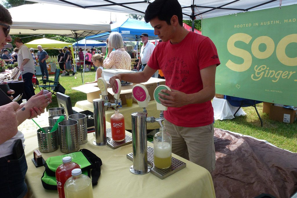 Roger Nuñez wrings the last of the jalapeño-lime SoCo ginger beer out of the tap at Denton Community Market.
